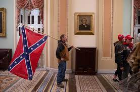 Man photographed with Confederate flag in U.S. Capitol during riot is  arrested | KTLA